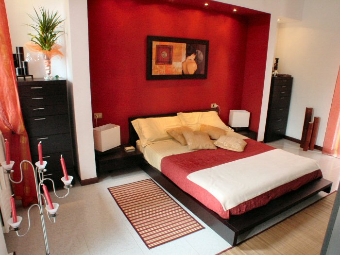 Stunning Parete Rossa Camera Da Letto Photos - Idee Arredamento Casa ...