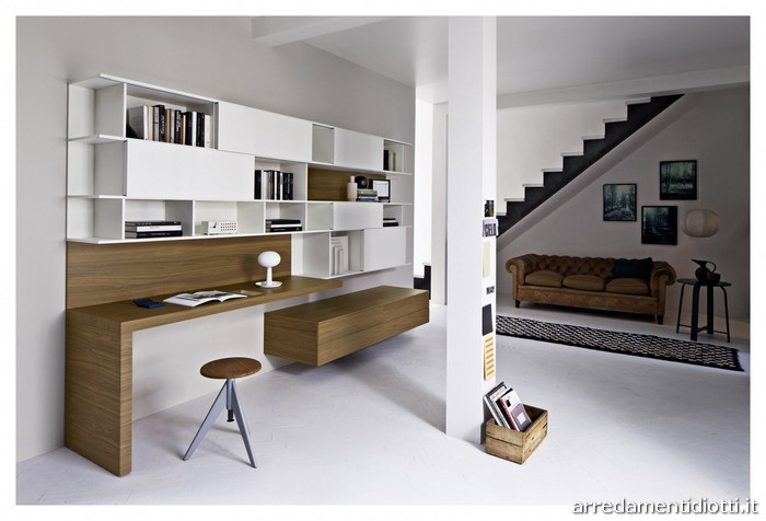 soggiorno moderno caratterizzato da elementi libreria con ante ... - Zona Studio In Soggiorno